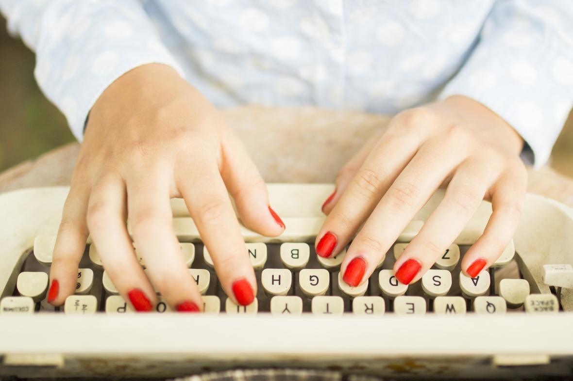 woman typing on a typewriter